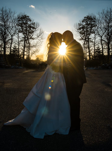 Bride and Groom at Sunset with star burst flare