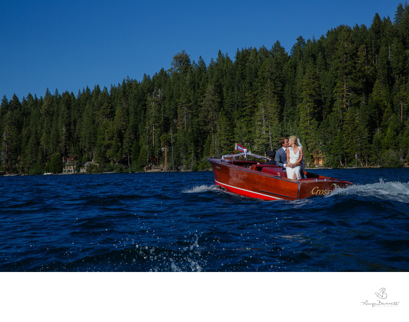 Wedding Portrait on Lake in Wooden Boat