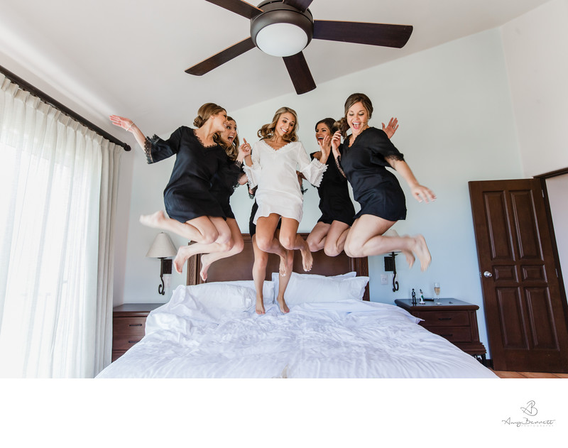Bridal Party Jumping on Bed