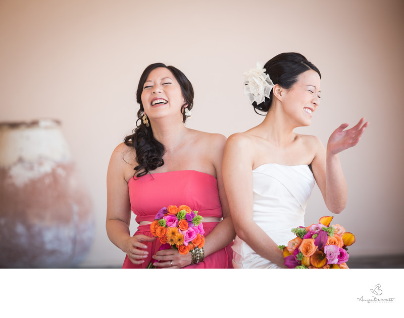 Sisters laughing at Wedding