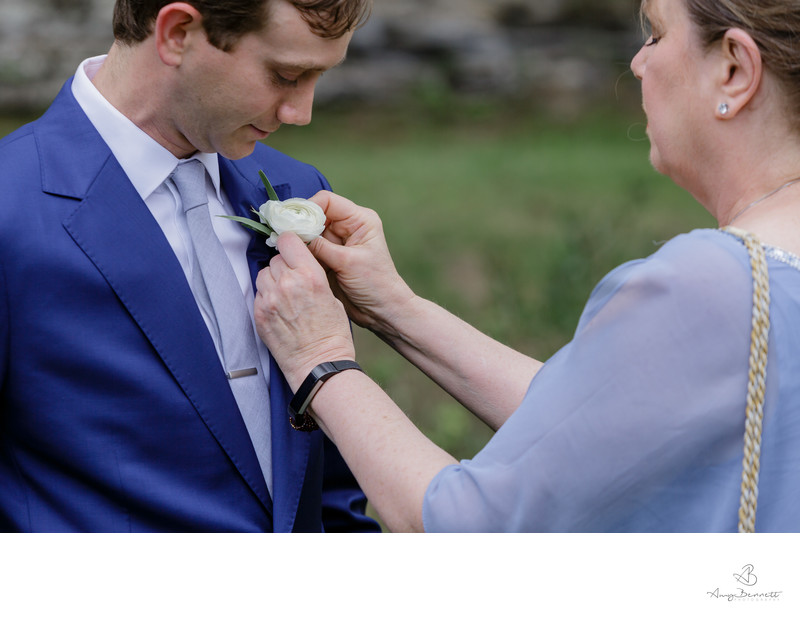 Mother of the Groom Affixes Boutonniere