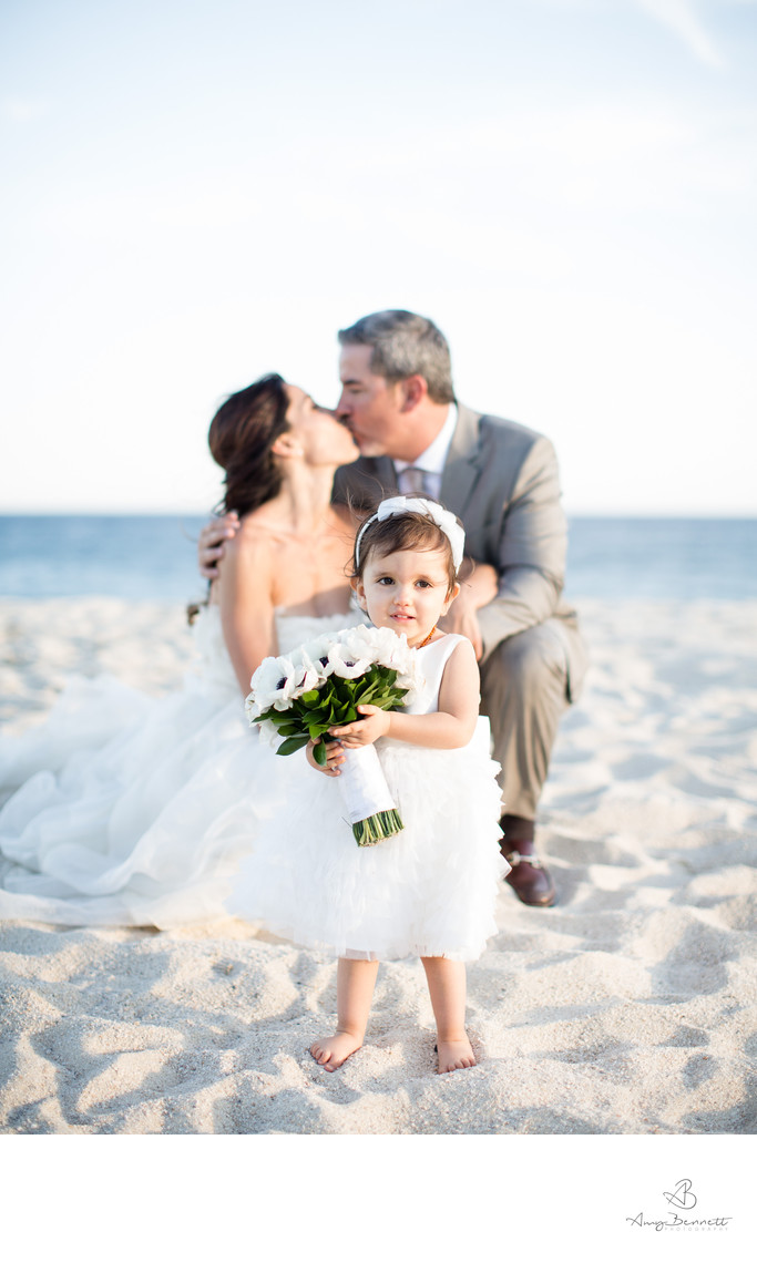 Flower Girl Holding the Bouquet on Beach