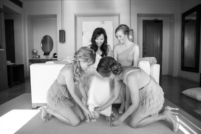 How many bridesmaids does it take to put on a shoe?