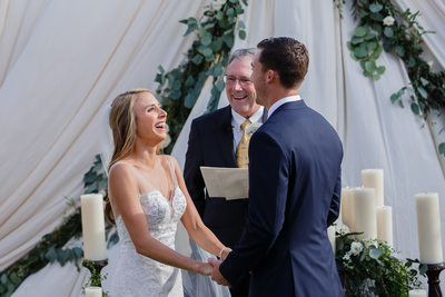 Laughing Bride and Groom During Ceremony