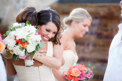 Bridesmaid Hugging Newly Married Bride