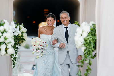 Excited Bride and Father Walking Down Aisle