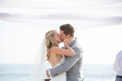 Bride and Groom Kiss Beach Ceremony