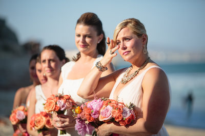 Tearful Bridesmaid Watching Bride Walk Down Aisle