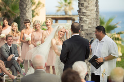 Wedding Party Delighted by Officiant