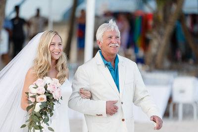 Bride and Father's Matching Smiles in the Aisle