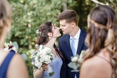 bride and groom Sneaking a kiss