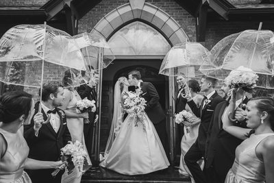 Rainy day wedding kiss