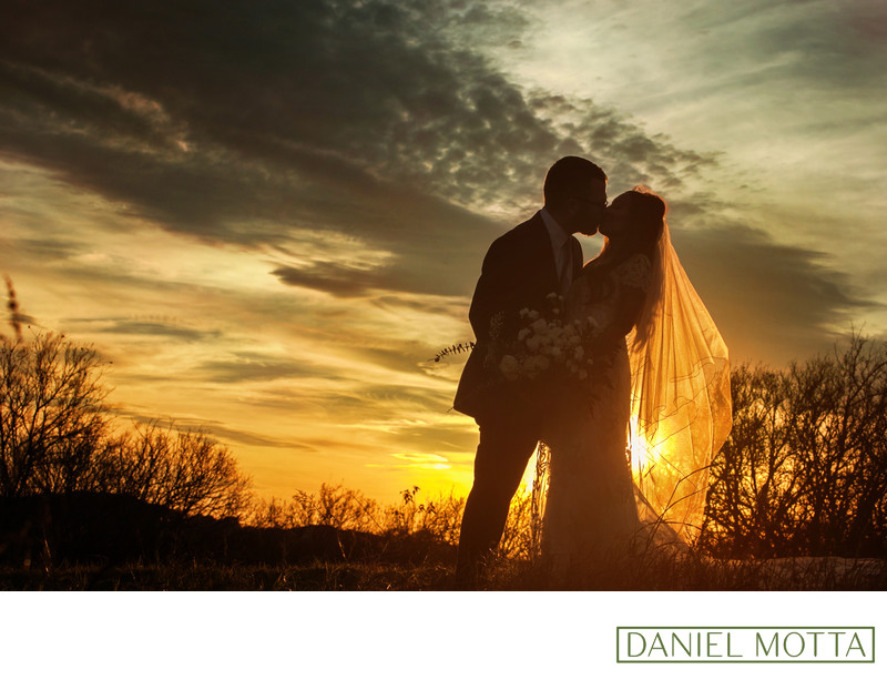 Sunset Wedding Photo of Couple Kissing at Arbor Hills