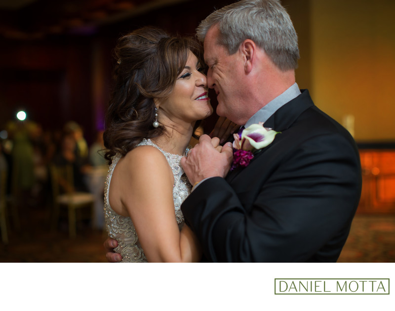 Wedding Photo of Newlywed Couple Smiling at 1st Dance