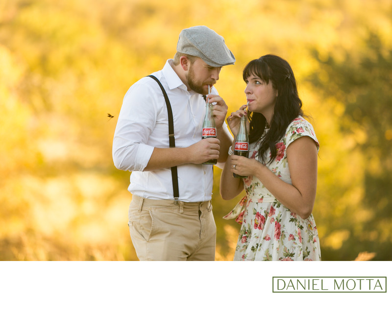 40's Themed Engagement Couple Sip Coca Cola