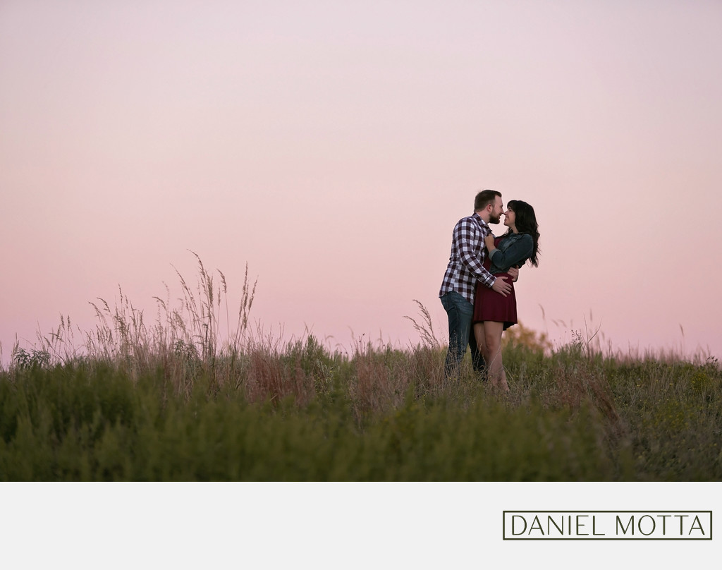 Engagement Photo of Couple at Sunset by Daniel Motta