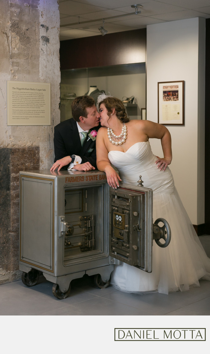 Dallas Newlywed Couple Kiss at Higginbotham Building