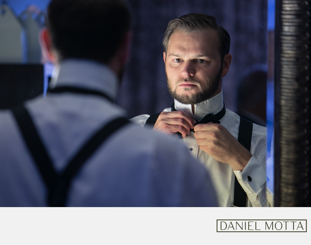 Dallas Photography of Groom Tying Bow-Tie at Magnolia