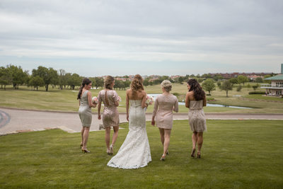 Outdoor Wedding Photography of Bridesmaids Walking