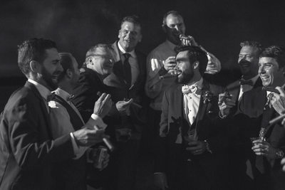 Dallas Wedding Photography of Groomsmen Smoking Cigars