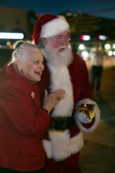 CEO of Ebby Halliday Laughs with Santa Claus