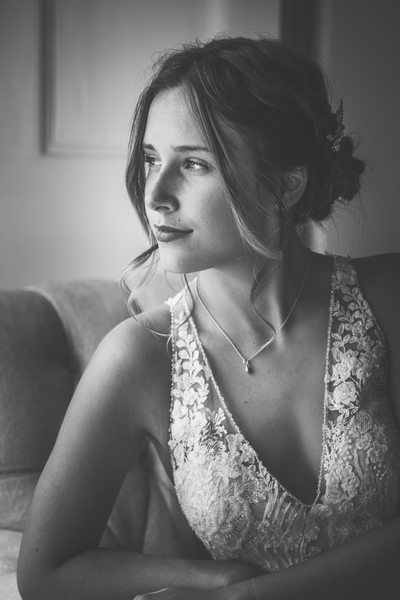 Bride looking out of the window, natural light photo