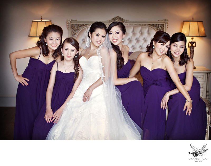 Bride with bridesmaids portrait in the morning on bed