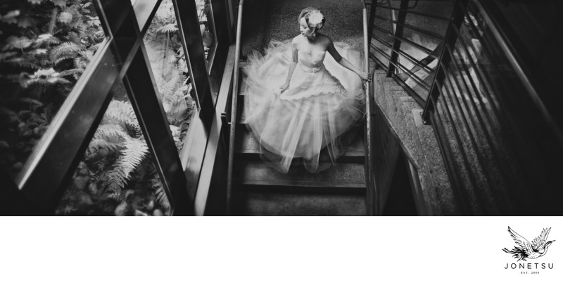 Bride in Lazaro gown on stairs Brentwood Bay Victoria