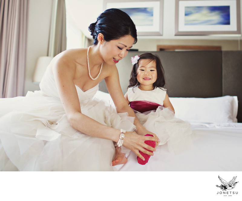 Bride with flower girl at the Loden Hotel Penthouse