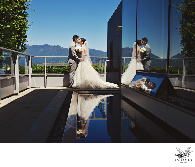 Reflections of bride and groom at Pac Rim Chairman's