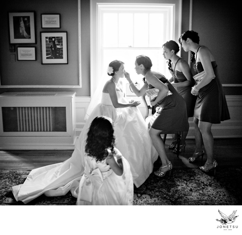 Bridesmaids help bride touchup before Hycroft ceremony