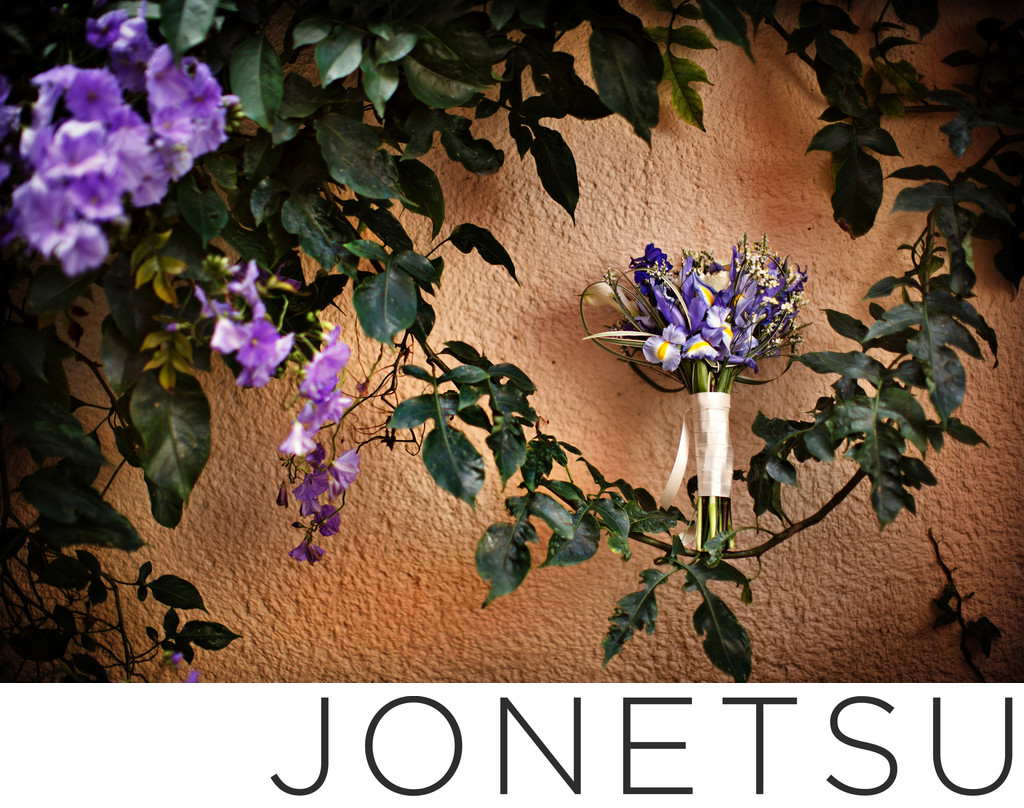 Bridal bouquet photographed on natural vines and purple
