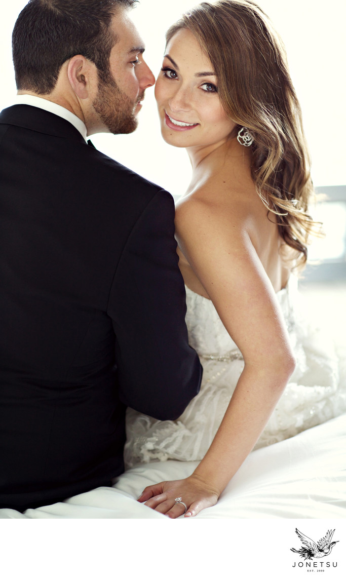 Wedding Couple Photo On The Bed At Fairmont Pacific Rim Weddings Jonetsu Photography