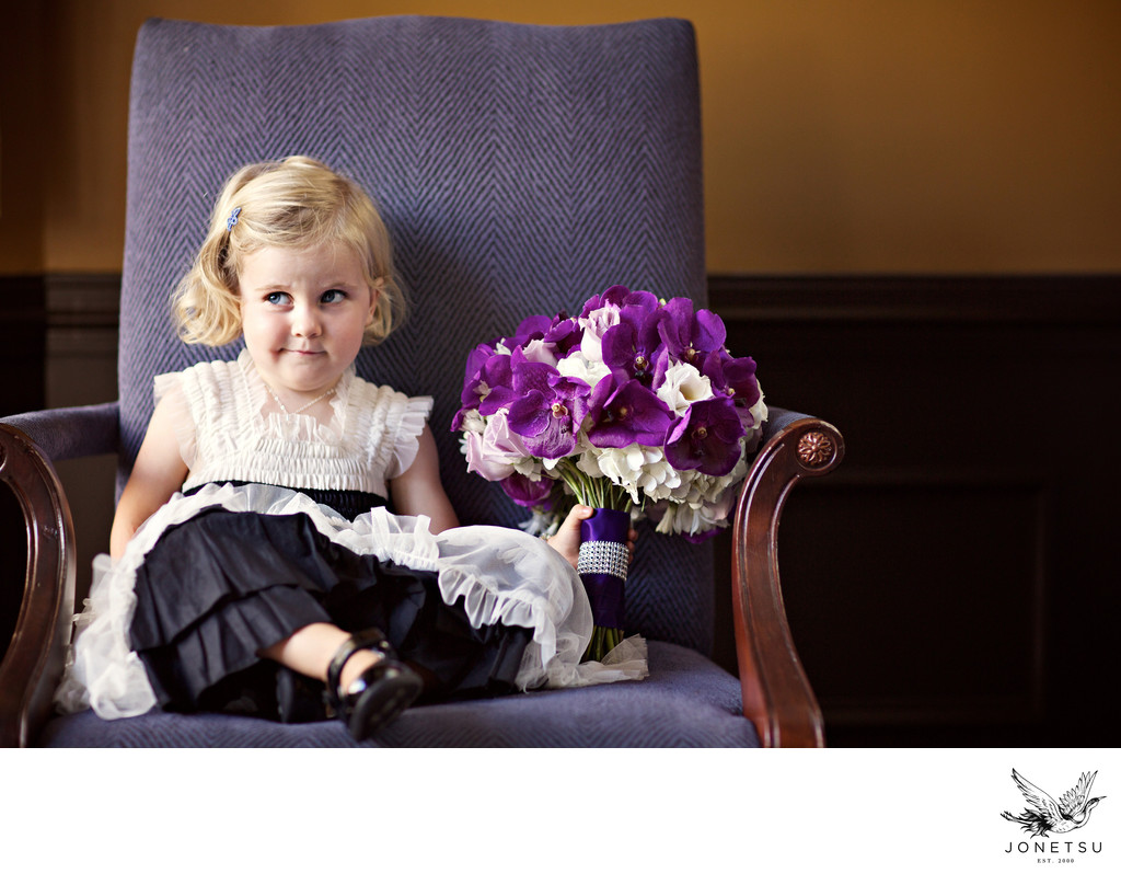 Flower girl is not impressed with this wedding bouquet