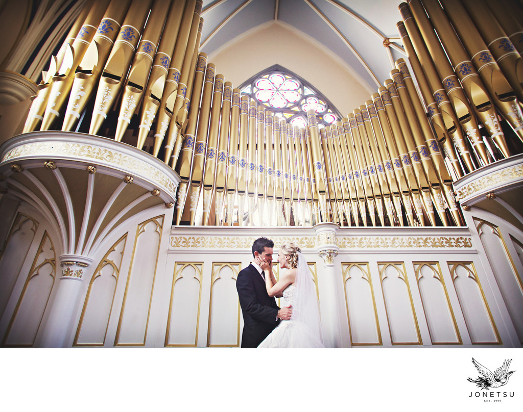 Wedding at Holy Rosary couple with organ photo