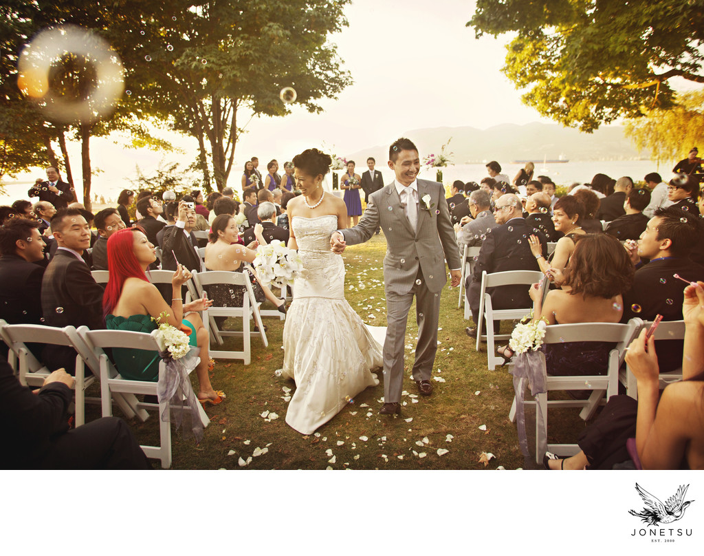 Brock House outdoor wedding aisle recessional with bubbles