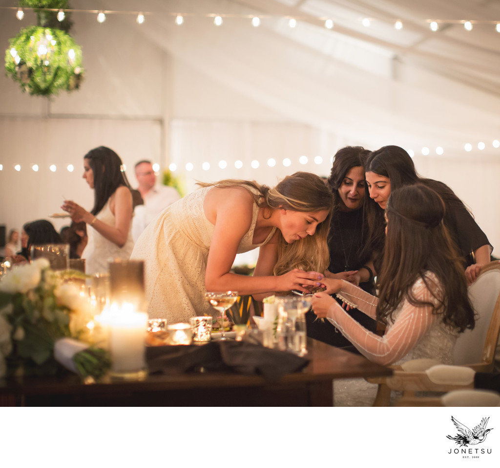 Richmond wedding tent guests admire brides ring