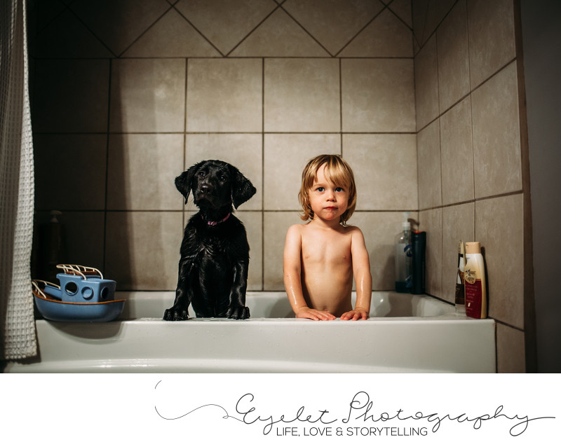 Puppy and Toddler in Tub