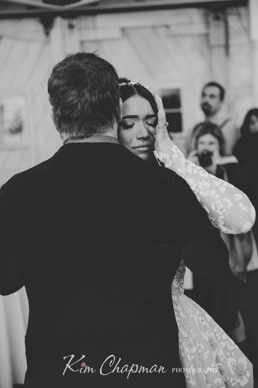 Bride Wipes a Tear During Dance with Dad