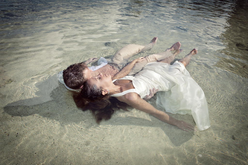 Couple Lying in Ocean at Jamaica Wedding