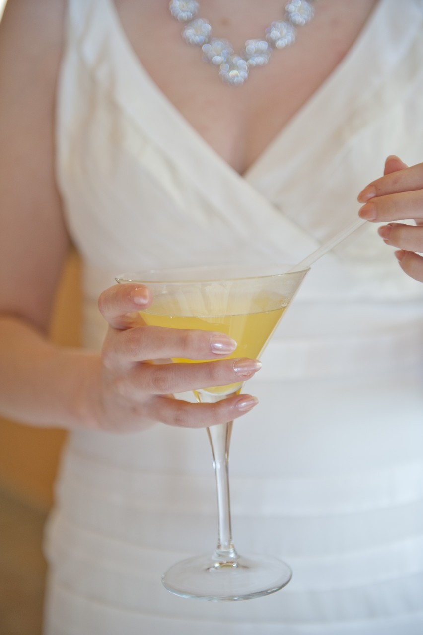 Bride holding Fruity Drink at Wedding