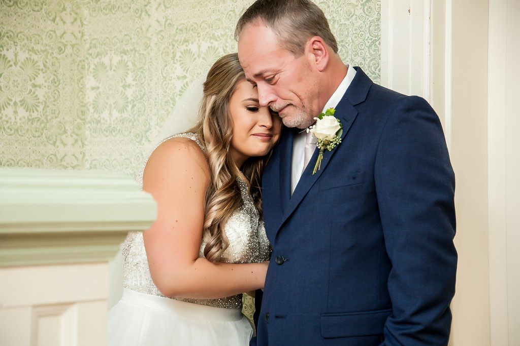 Bride's final moment with daddy before walking aisle