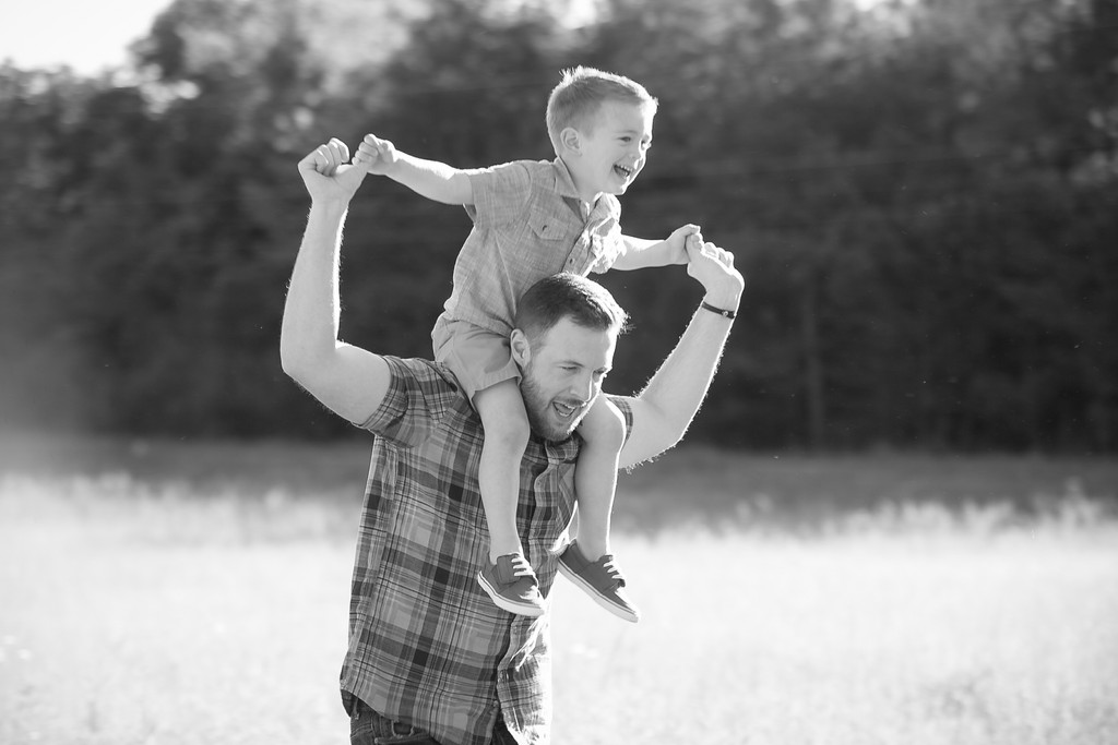 Documentary Photo of Dad with Son on Shoulders Running