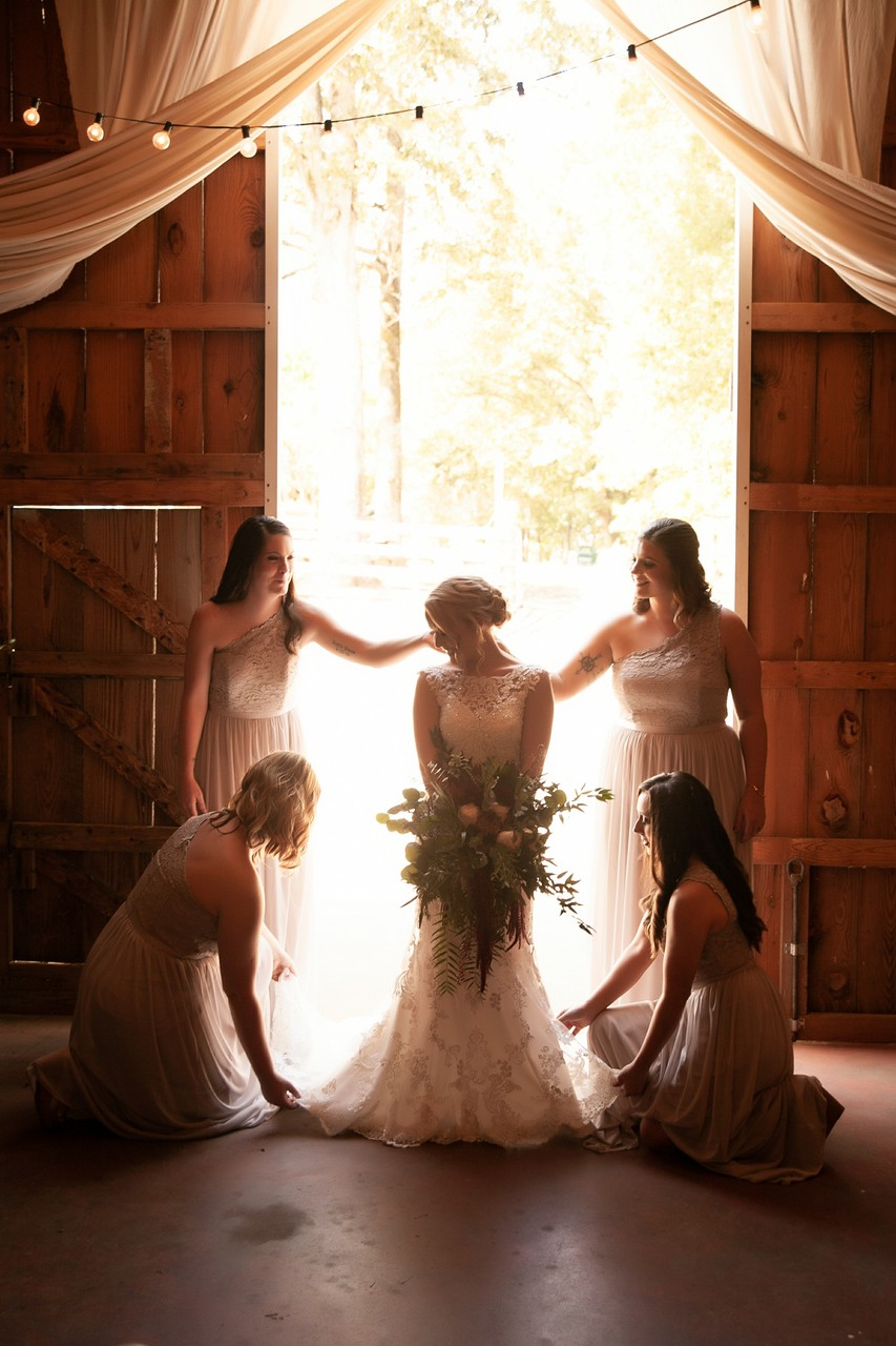 bride with bridesmaids in doorway Arran Farm, Easley SC