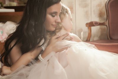 Bride holding daughter in bridal suite of Arran Farm