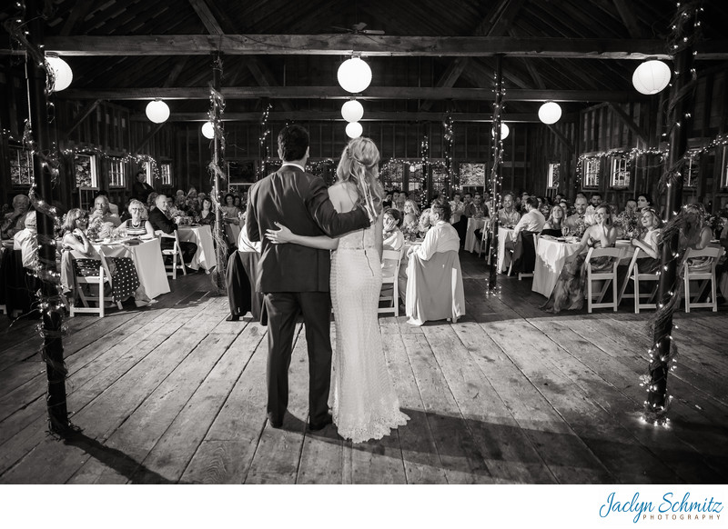 Bride and Groom hug while giving wedding thank you speech