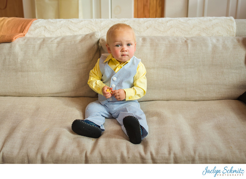Cute little boy in yellow and blue suit