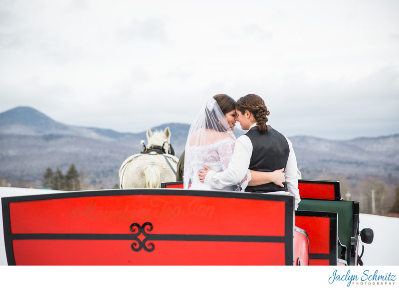 Horse drawn carriage winter wedding Vermont