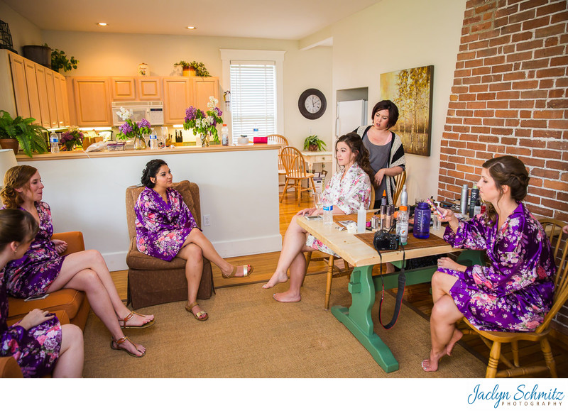 Bridesmaids watch Bride get ready