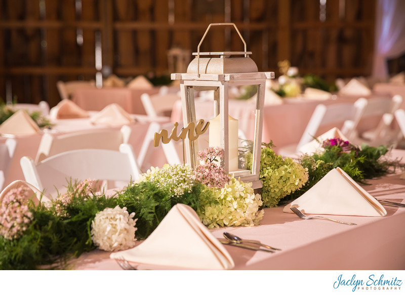 white lantern and table greenery wedding decor
